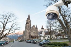 Close-up of a CCTV Security Camera in front of a church.